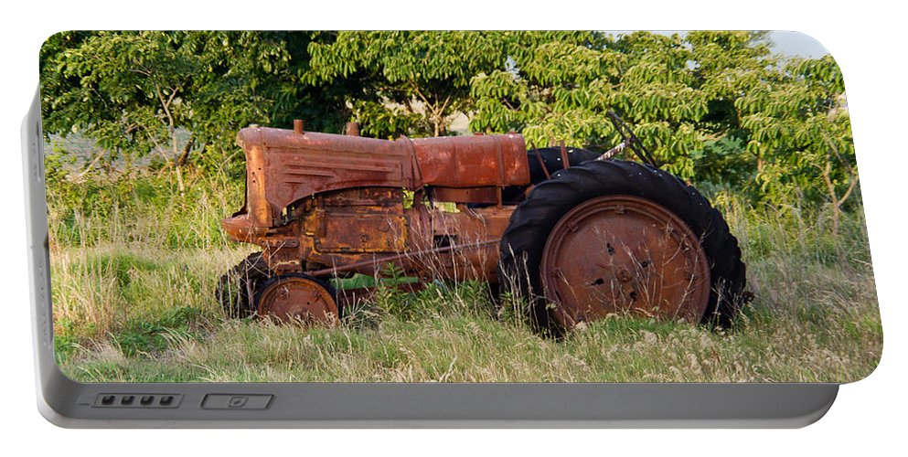 Tractor Portable Battery Charger featuring the photograph Forgotten Tractor 23 by Douglas Barnett