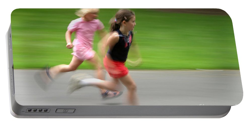 Run Portable Battery Charger featuring the photograph Girls Running by Ted Kinsman