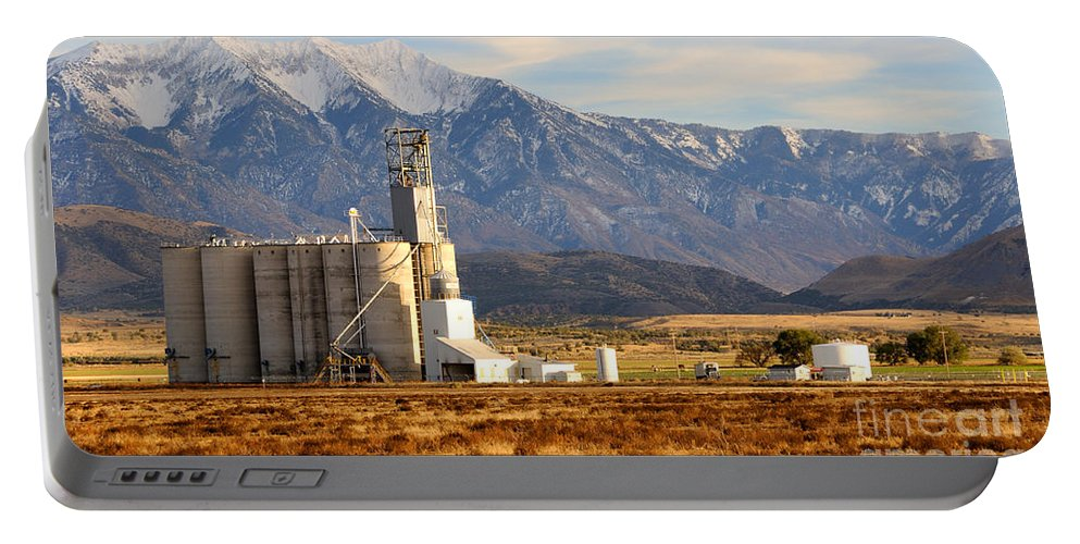 Wasatch Portable Battery Charger featuring the photograph Grain Silo Below Wasatch Range - Utah by Gary Whitton