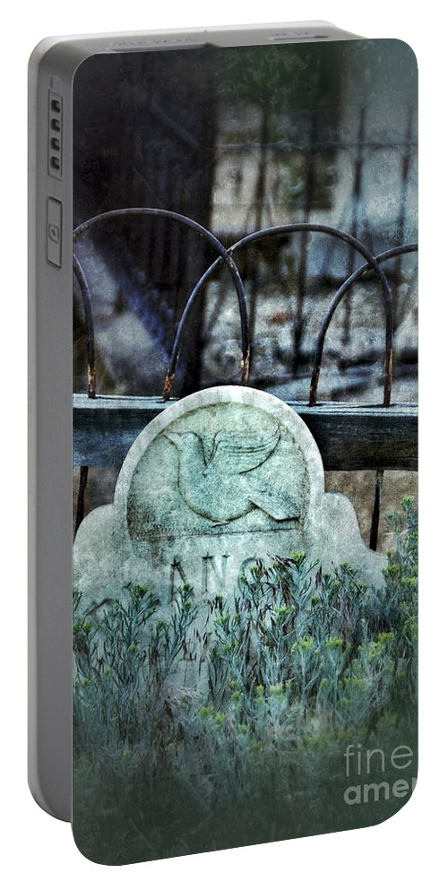 Iron Portable Battery Charger featuring the photograph Gravestone With Dove Carved by Jill Battaglia