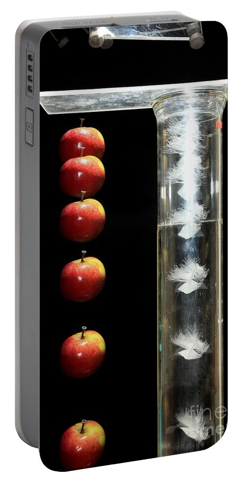 Acceleration Portable Battery Charger featuring the photograph Gravity Comparison by Ted Kinsman