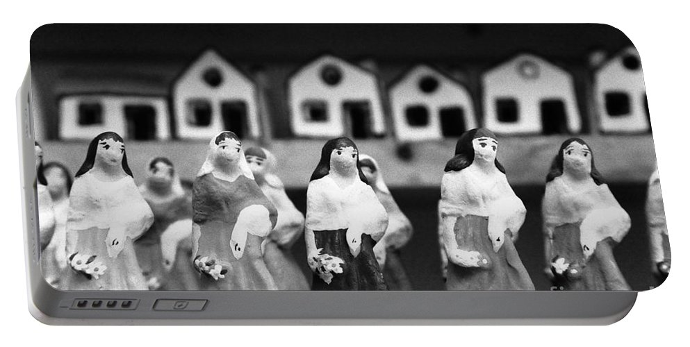Figurines Portable Battery Charger featuring the photograph Handpainted Figurines by Gaspar Avila
