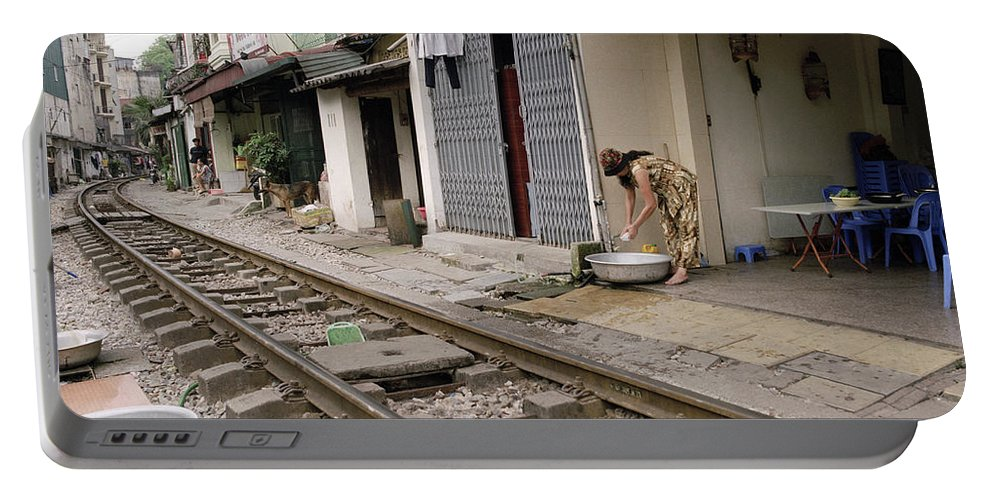 Asia Portable Battery Charger featuring the photograph Hanoi Daily Life by Shaun Higson
