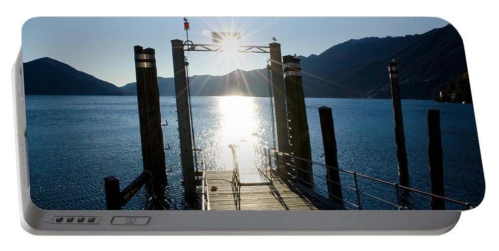 Port Portable Battery Charger featuring the photograph Harbor And Sun by Mats Silvan