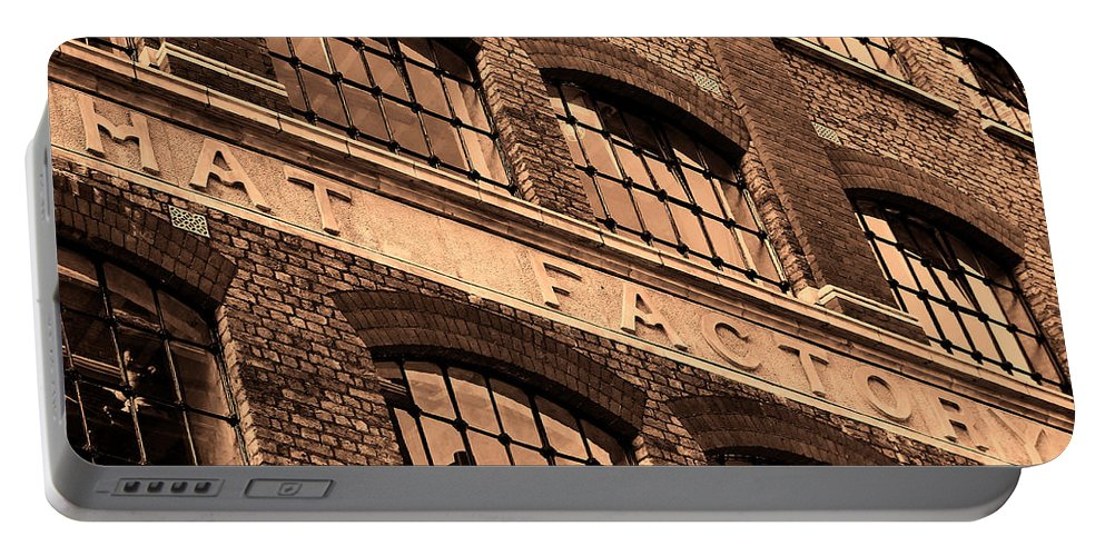 Hat Factory Portable Battery Charger featuring the photograph Hat Factory by Jasna Buncic