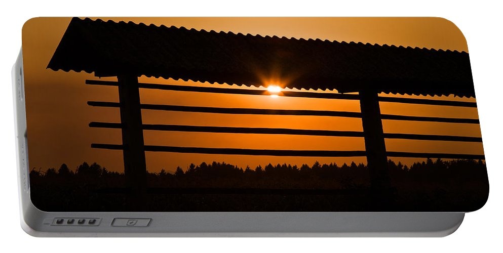 Kozolec Portable Battery Charger featuring the photograph Hazy Summer Sunset by Ian Middleton
