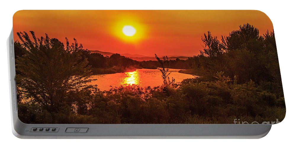 Sunrise Portable Battery Charger featuring the photograph Hazy Sunrise by Robert Bales