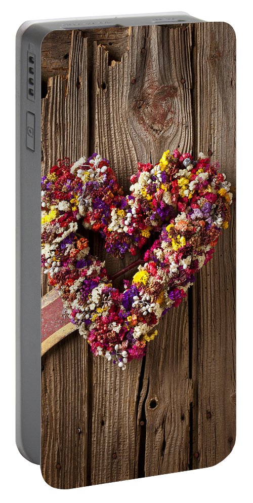Heart Portable Battery Charger featuring the photograph Heart Wreath With Weather Vane Arrow by Garry Gay