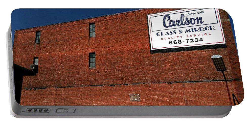 Brick Wall Building Old Sign American Wisconsin Kenosha Blue Sky Store Small Town Parking Lot Red White Sign Glass Mirror Carlson Portable Battery Charger featuring the photograph In Wisconsin by Gabe Arroyo