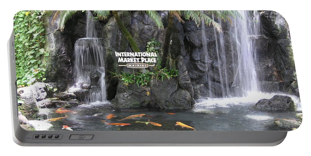 Honolulu Portable Battery Charger featuring the photograph International Marketplace - Waikiki by Mary Deal