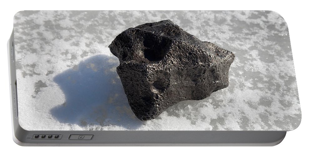 Meteor Portable Battery Charger featuring the photograph Iron Nickel Meteorite On Ice by Ted Kinsman