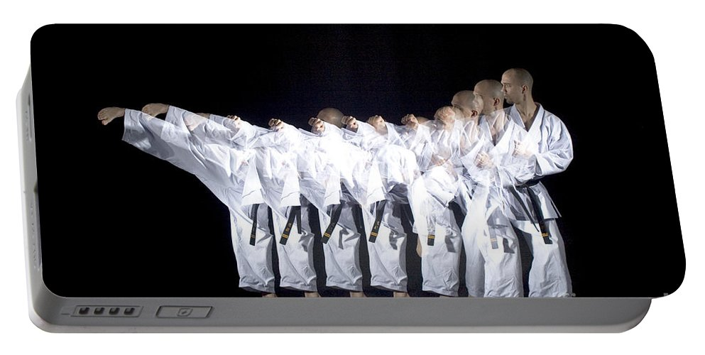 Stroboscopic Portable Battery Charger featuring the photograph Karate Expert by Ted Kinsman