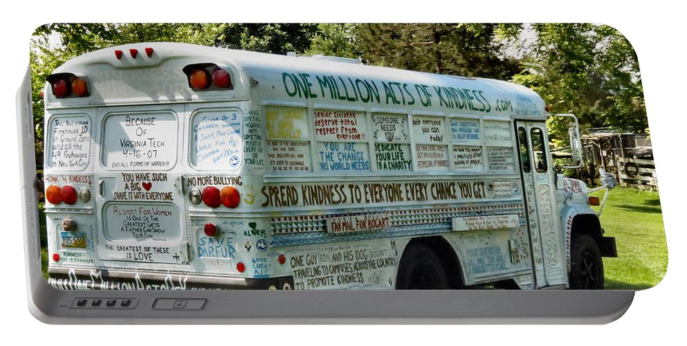 One Portable Battery Charger featuring the photograph Kindness Bus 2 by Art Dingo