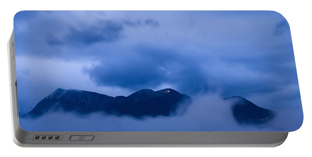 Krvavec Portable Battery Charger featuring the photograph Krvavec Breaks Through After The Rain by Ian Middleton