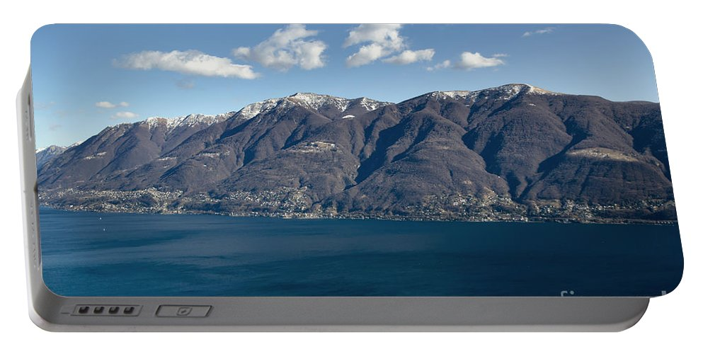 Islands Portable Battery Charger featuring the photograph lake with Brissago islands and snow-capped mountain by Mats Silvan
