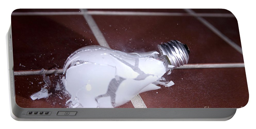 Light Bulb Portable Battery Charger featuring the photograph Light Bulb Smashing by Ted Kinsman