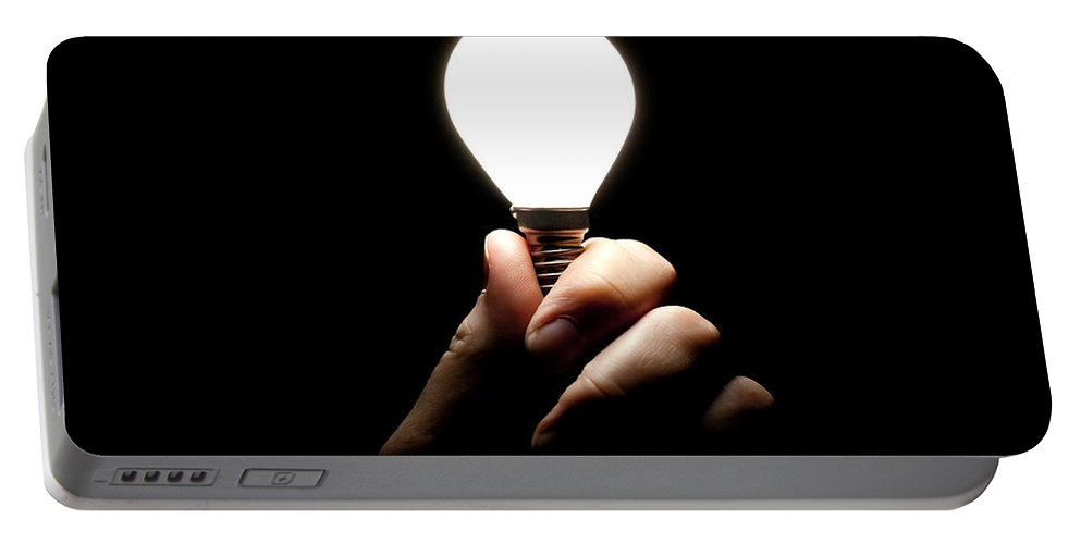 Light Bulb Portable Battery Charger featuring the photograph Lit Lightbulb Held In Hand by Simon Bratt Photography LRPS