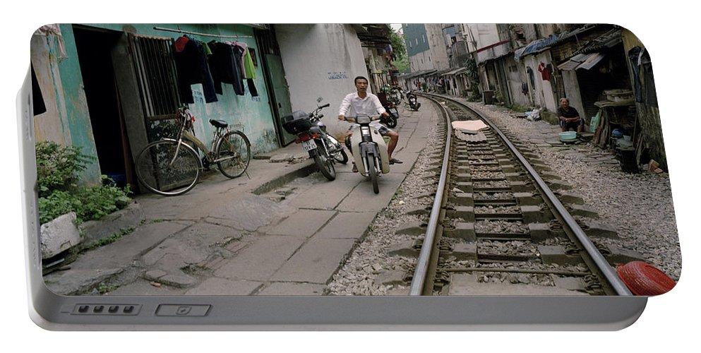 Asia Portable Battery Charger featuring the photograph Living By The Tracks In Hanoi by Shaun Higson