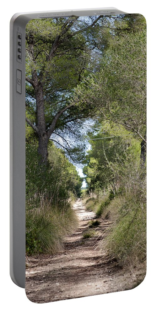 Menorca Portable Battery Charger featuring the photograph Long Forest Road by Pedro Cardona Llambias
