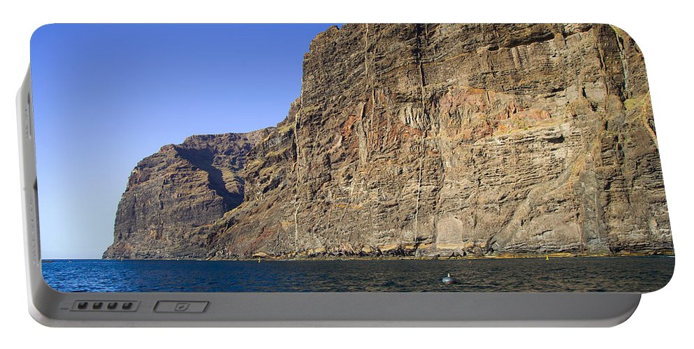 Cliff Portable Battery Charger featuring the photograph Los Gigantes Cliffs by Artur Bogacki