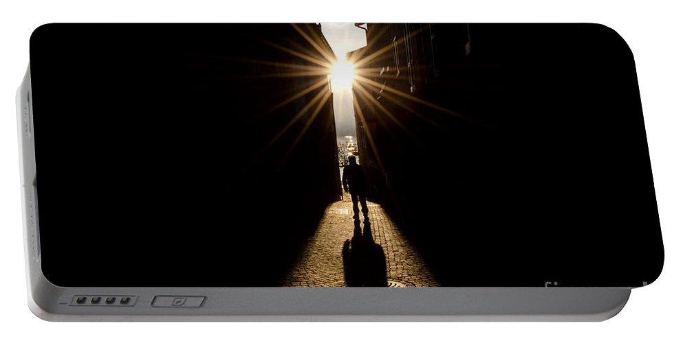 Man Portable Battery Charger featuring the photograph Man In Backlight by Mats Silvan