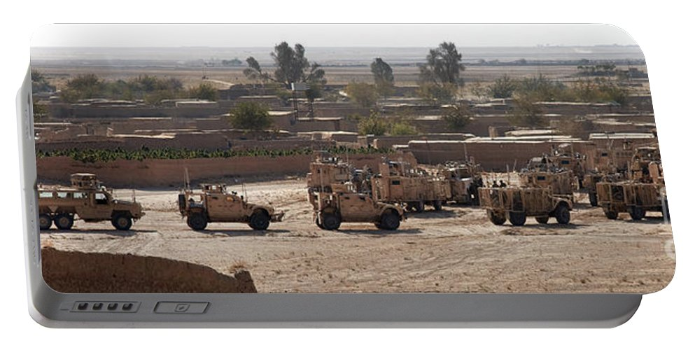 Operation Enduring Freedom Portable Battery Charger featuring the photograph Military Vehicles Parked Outside Loy by Stocktrek Images