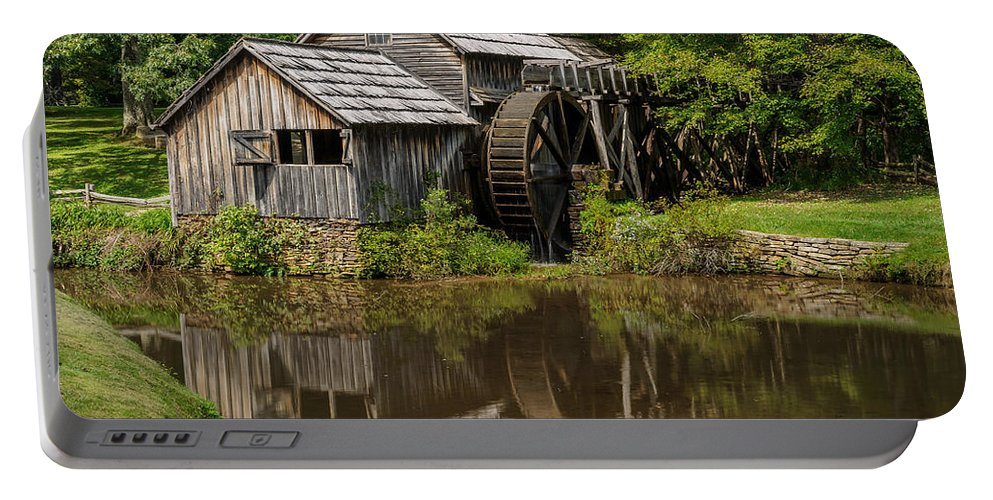 Summer Portable Battery Charger featuring the photograph Mill Pond Reflection by Charlie Choc