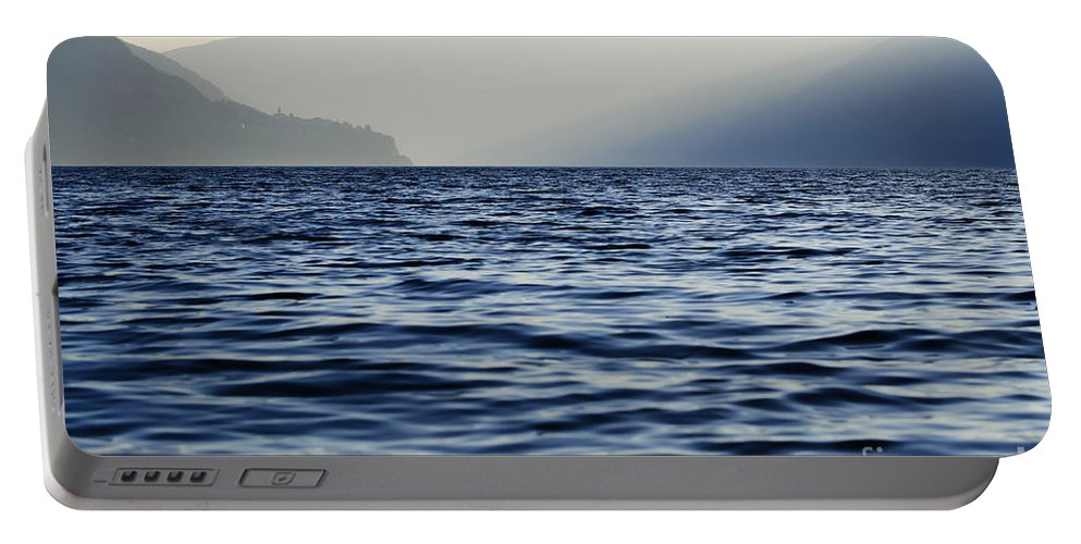 Lake Portable Battery Charger featuring the photograph Misty Alpine Lake With Mountains by Mats Silvan