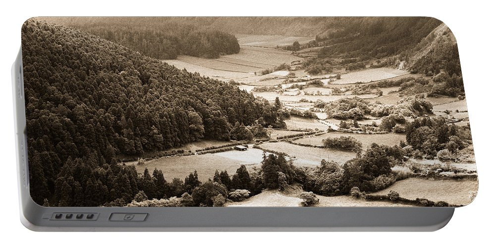 Rural Portable Battery Charger featuring the photograph Misty Valley by Gaspar Avila