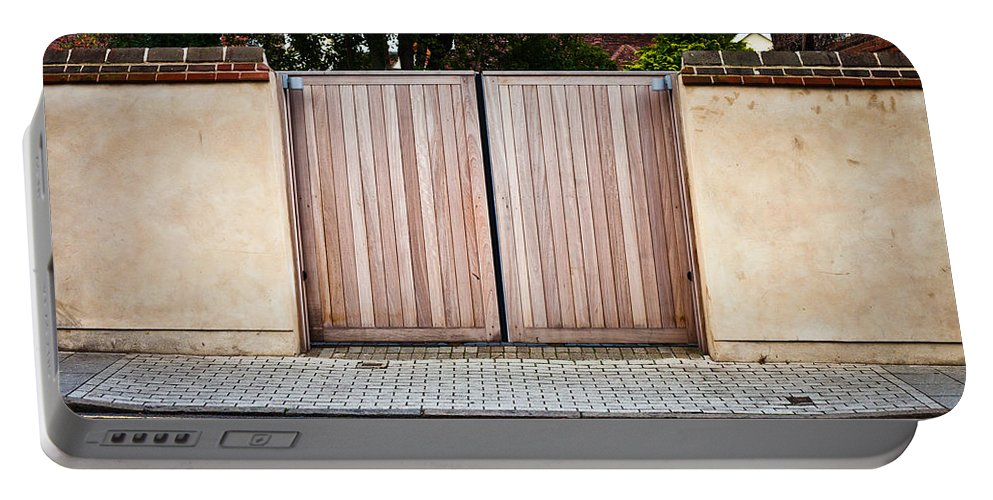 Architecture Portable Battery Charger featuring the photograph Modern Gate by Tom Gowanlock