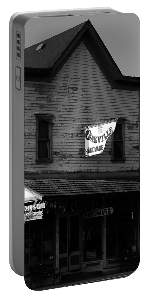 Fine Art Photography Portable Battery Charger featuring the photograph Oakville Hardware 1890 by David Lee Thompson