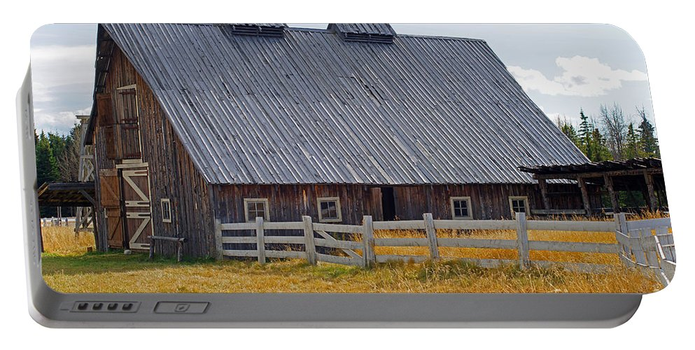 Old Barn Portable Battery Charger featuring the photograph Old Barn And Fence by Randy Harris