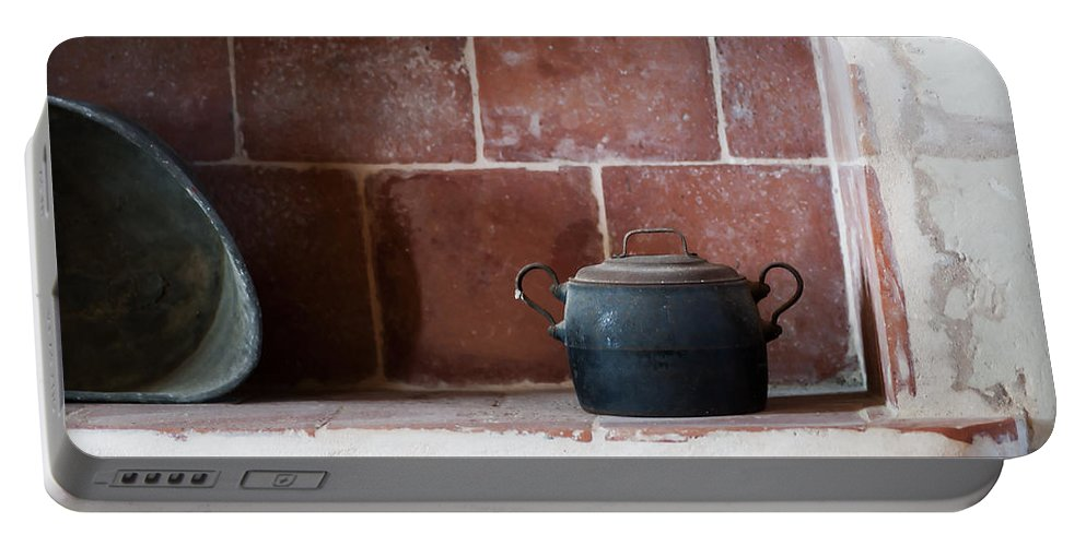 Scene Portable Battery Charger featuring the photograph old kitchen - A part of a traditional kitchen with a vintage metal pot by Pedro Cardona Llambias