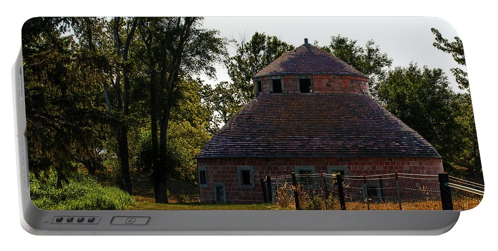 Barns Portable Battery Charger featuring the photograph Old Round Barn by Edward Peterson