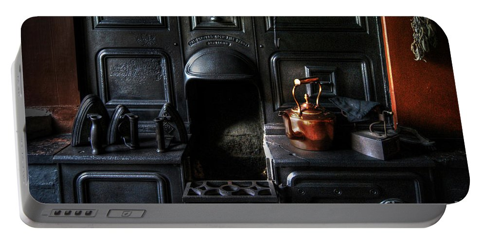 Kitchen Portable Battery Charger featuring the photograph Old Stove by Yhun Suarez