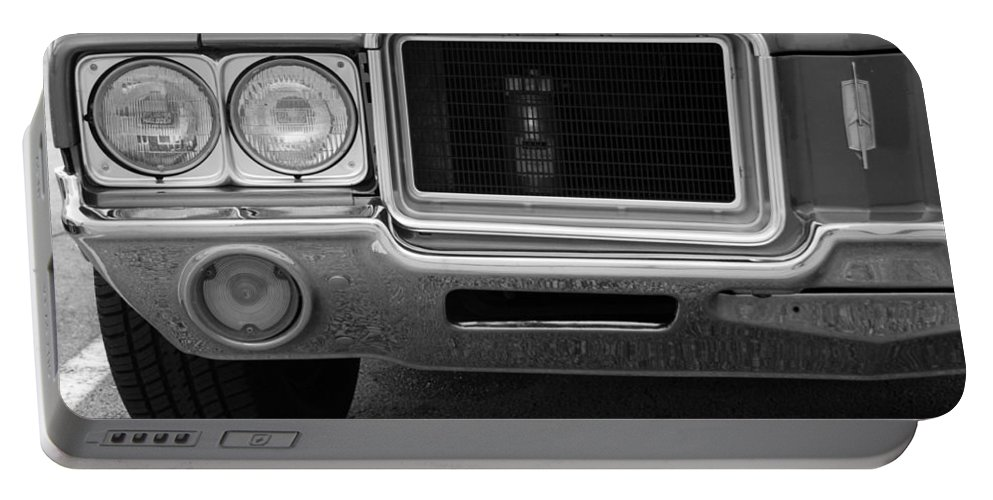 Oldsmobile Portable Battery Charger featuring the photograph Olds C S In Black And White by Rob Hans
