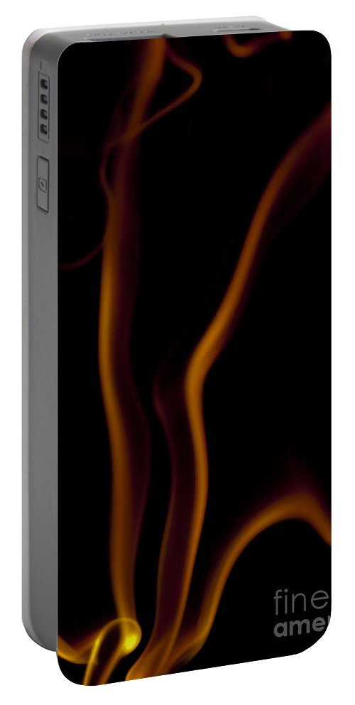 Abstract Portable Battery Charger featuring the photograph Orange Insence Smoke by Darcy Michaelchuk