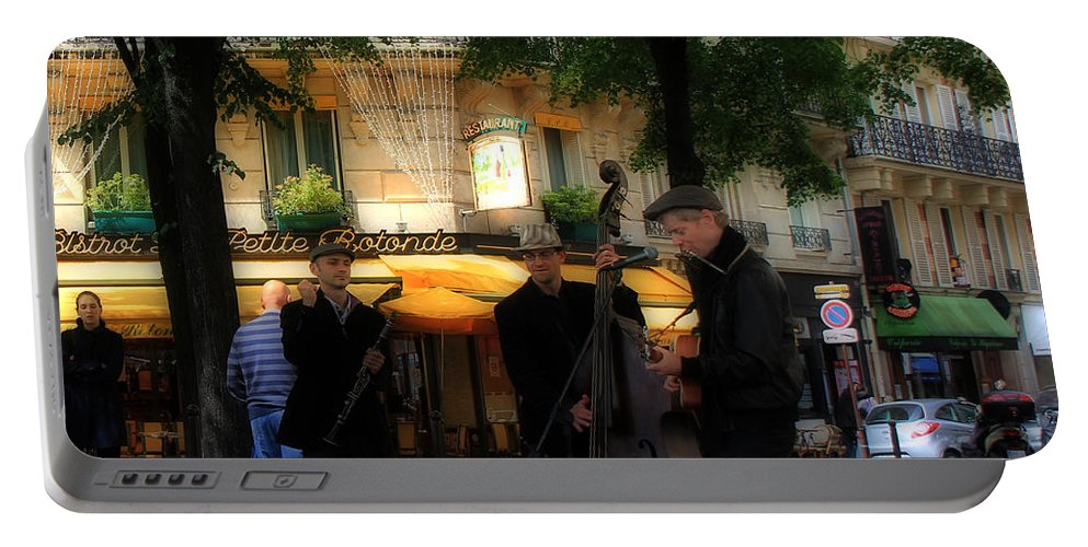 Paris Portable Battery Charger featuring the photograph Paris Musicians by Andrew Fare