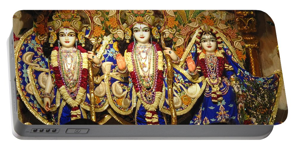 Temple Portable Battery Charger featuring the photograph People Offering Prayers At The Iskcon Temple In Delhi by Ashish Agarwal