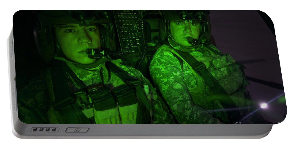 Aviation Portable Battery Charger featuring the photograph Pilots In The Cockpit Of An Oh-58d by Terry Moore
