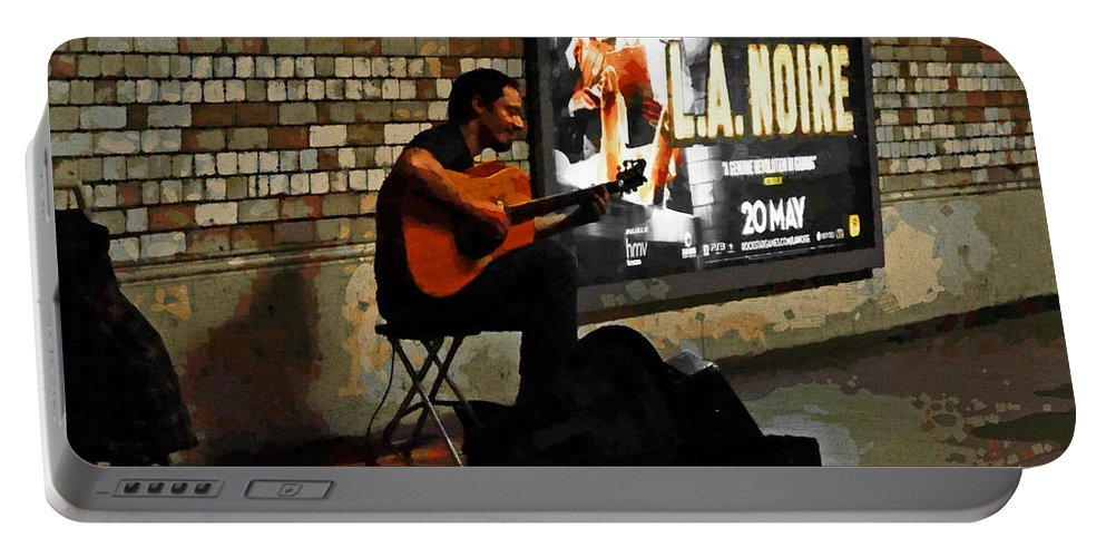 Underground Portable Battery Charger featuring the photograph Play It Again Sam by Steve Taylor