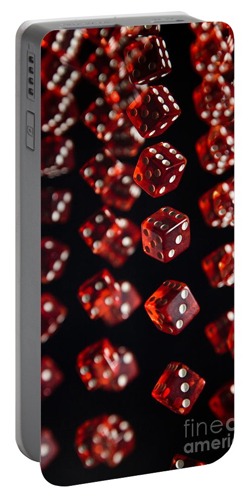 Roll Portable Battery Charger featuring the photograph Playing Dice Being Rolled by Ted Kinsman
