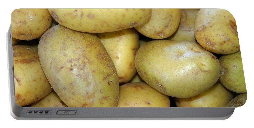 Agriculture Portable Battery Charger featuring the photograph Potatoes by Henrik Lehnerer