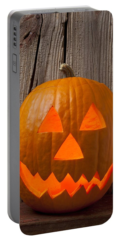Pumpkin Portable Battery Charger featuring the photograph Pumpkin With Wicked Smile by Garry Gay