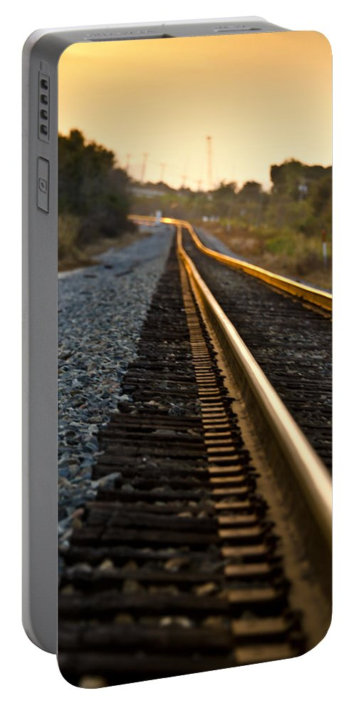Train Portable Battery Charger featuring the photograph Railroad Tracks At Sundown by Carolyn Marshall