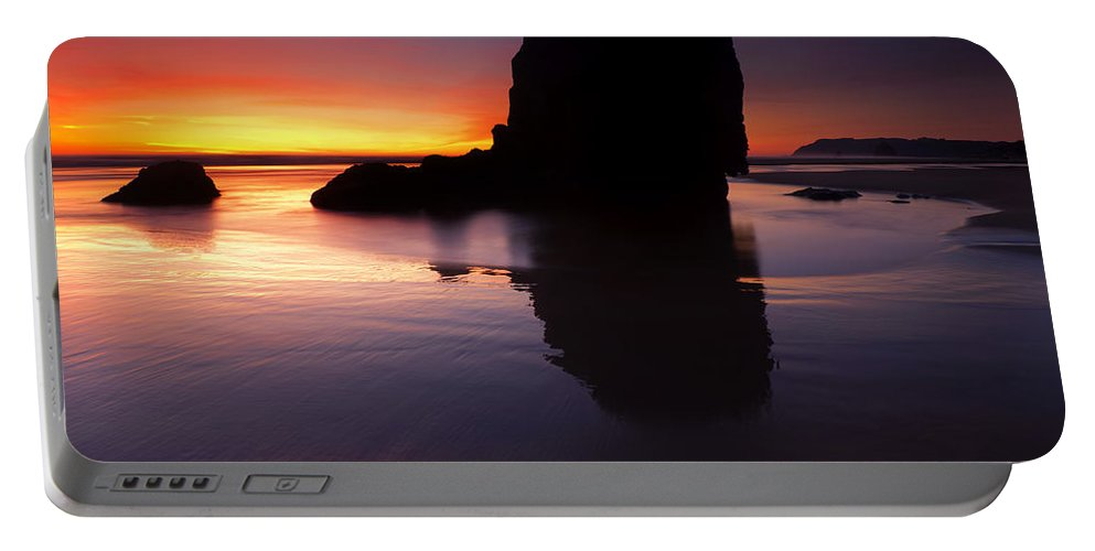 Cannon Beach Portable Battery Charger featuring the photograph Reflections Of The Tides by Mike Dawson