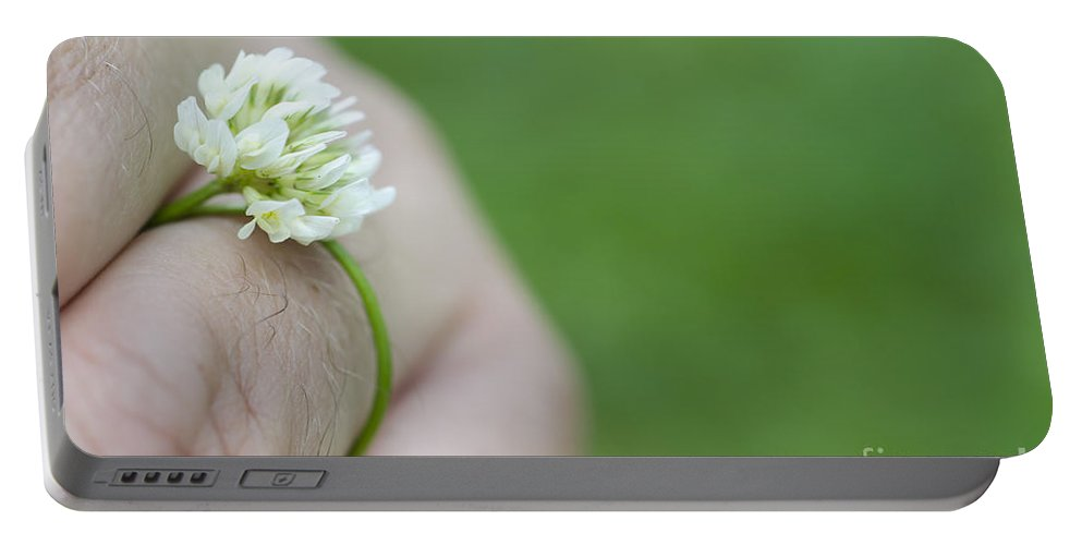 Ring Portable Battery Charger featuring the photograph Ring Flower by Mats Silvan