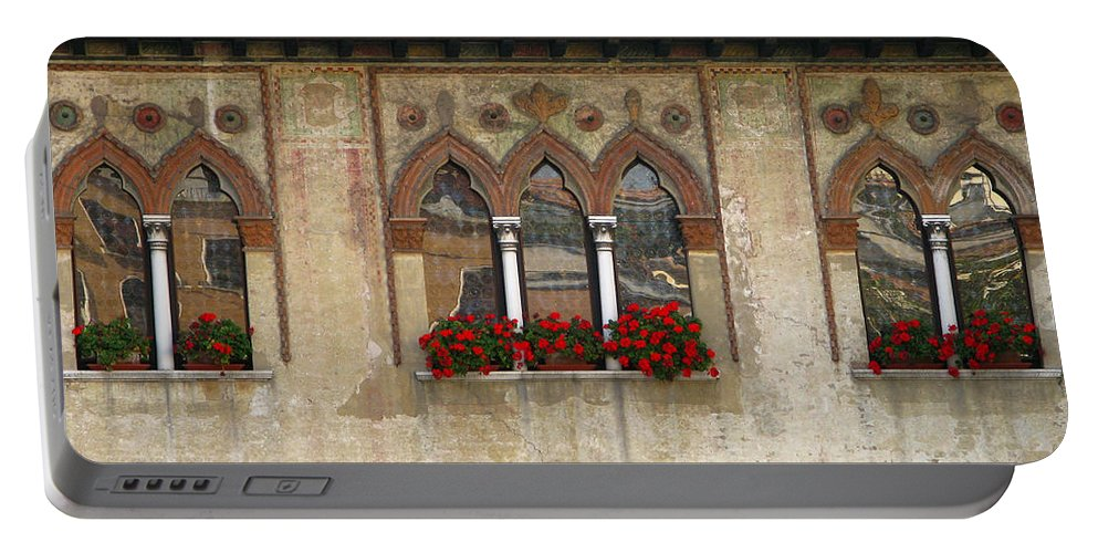 Windows Portable Battery Charger featuring the photograph Row Of Windows In Treviso Italy by Greg Matchick