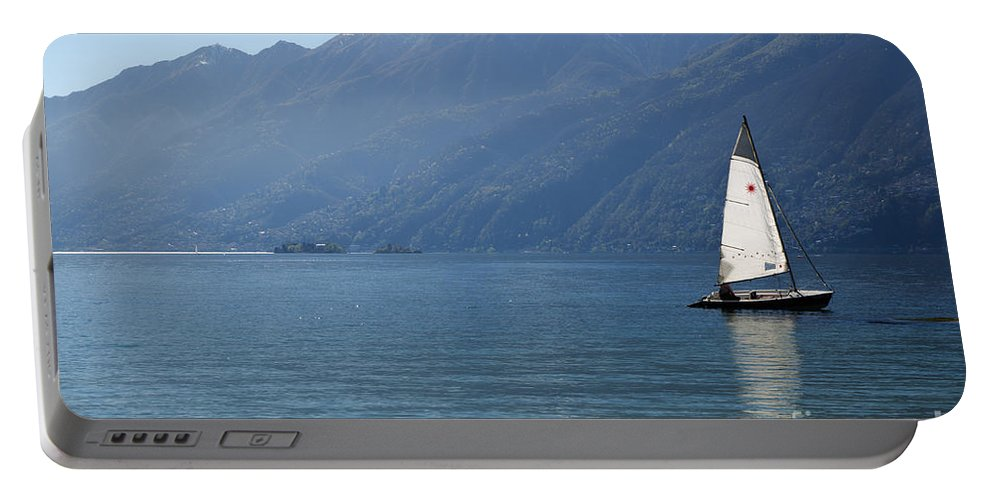 Sailing Boat Portable Battery Charger featuring the photograph Sailing Boat And Mountain by Mats Silvan