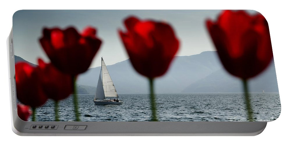 Sailing Boat Portable Battery Charger featuring the photograph Sailing Boat And Tulip by Mats Silvan